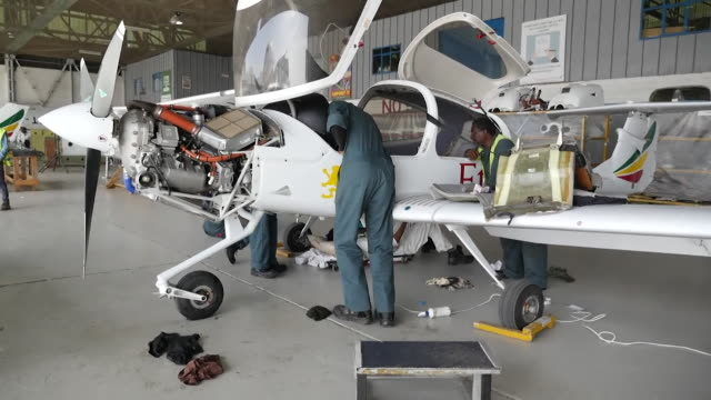 ethiopian airlines diamond da40 four seater plane being checked and repaired in maintenance shed at airport in ethiopia - engineering stock videos & royalty-free footage