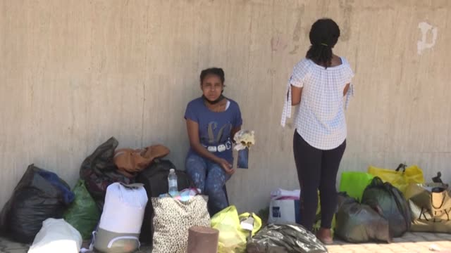 ethiopian domestic workers wait outside their country's consulate in the hazmieh suburb of the lebanese capital beirut to register for repatriation... - lebanon country stock videos & royalty-free footage