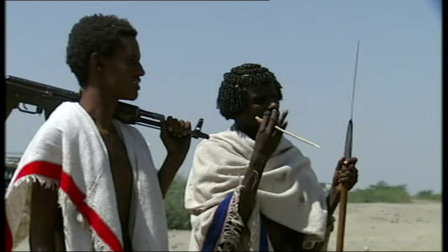 ethiopian government makes indirect contact with hostage takers; ethiopia: afar region: ext good shots of afar rebel soldiers, one carrying a gun the... - ethiopia stock videos & royalty-free footage