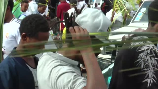 ethiopian orthodox christians gather to attend the hosanna day celebrations ahead of the easter at the bole medehanialem church in addis ababa... - äthiopien stock-videos und b-roll-filmmaterial