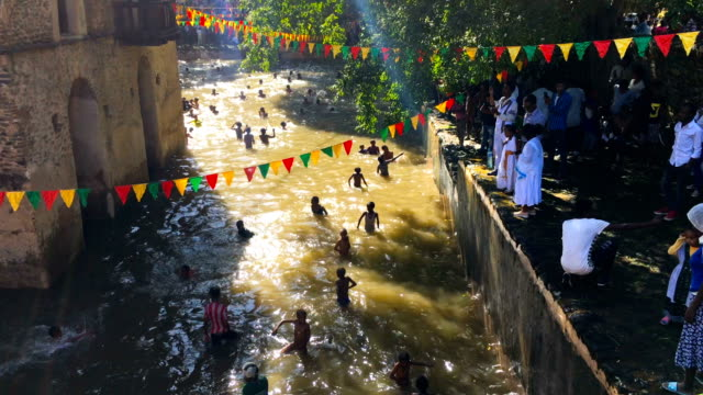 ethiopian orthodox worshippers swim in fasilides bath during the annual timkat epiphany celebration on january 19 2017 in gondar ethiopia timkat is... - gondar stock videos and b-roll footage