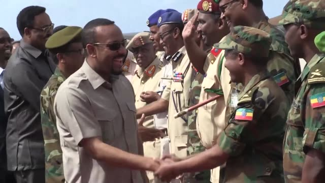 ethiopian prime minister abiy ahmed is greeted by eritrea's president isaias afwerki in the capital asmara at the start of a meeting to repair... - corno d'africa video stock e b–roll