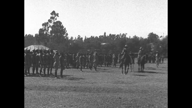 ethiopian soldiers standing at attention in formation / various of ethiopian emperor haile selassie reviewing soldiers marshalled in field from... - black and white stock videos & royalty-free footage