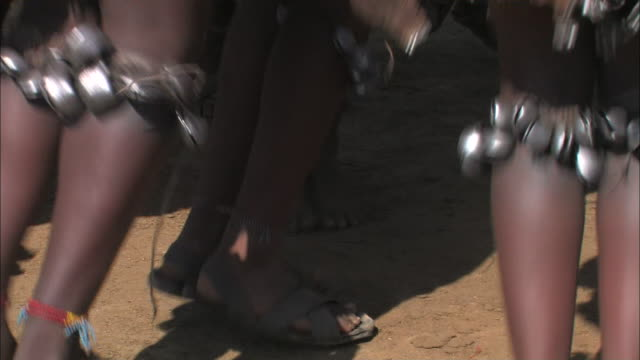 ethiopian women wear bells on their legs as they perform a rhythmic, hopping dance. - horn of africa stock videos & royalty-free footage