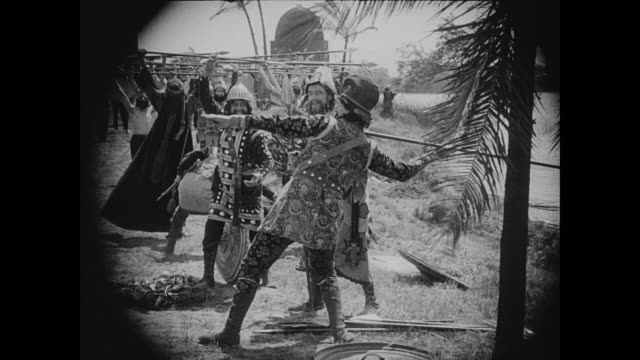 ethiopians and barbarians discuss their plans for attack - 1916年点の映像素材/bロール