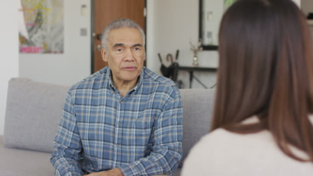 ethnic adult senior male in a therapy session - mental health professional stock videos & royalty-free footage