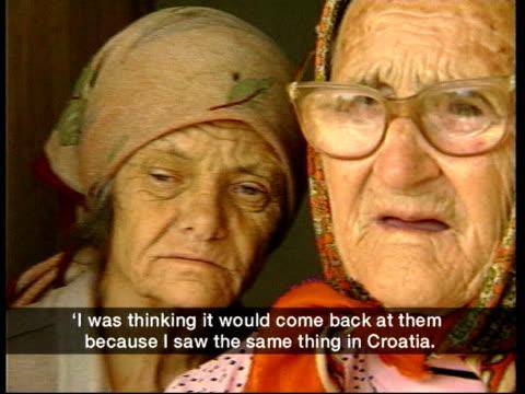 vídeos de stock, filmes e b-roll de ethnic albanians block russian convoy itn aid workers towards carrying supplies to village cmss elderly serb women waiting at door for supplies jane... - teste de coloração