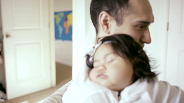 ethnic baby sleeping on father in nursery - napping stock videos & royalty-free footage