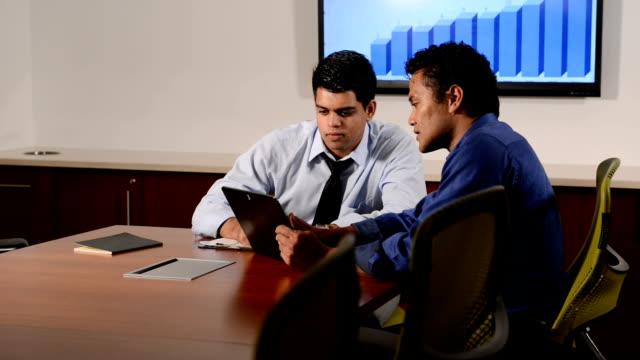 Ethnic Businessmen Collaborate using Digital Tablet
