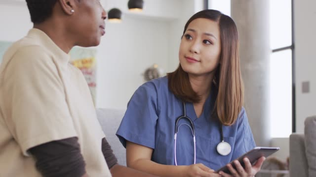 Ethnic Female Senior Getting Medical Check Up