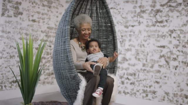 ethnic grandmother playing with her grandson - fatcamera stock videos and b-roll footage