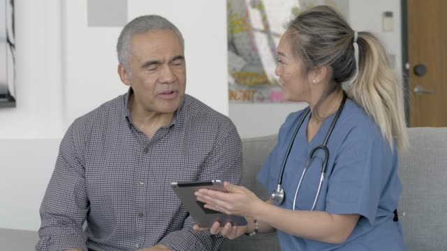 ethnic male senior getting medical check up - mental illness stock videos & royalty-free footage