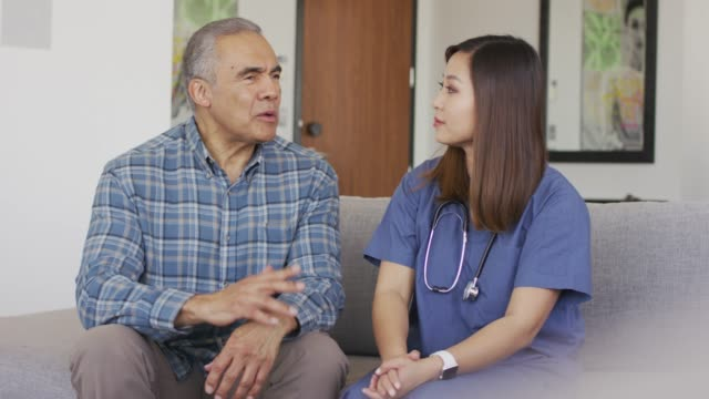ethnic male senior getting medical check up - alertness stock videos & royalty-free footage