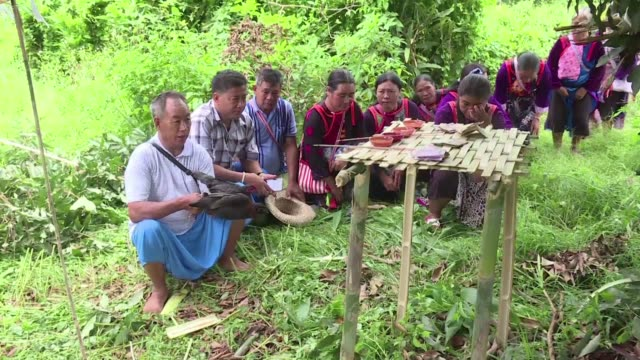 ethnic minority lisu tribespeople make offerings to the river and forest spirits as rescuers try to reach a teenage football team of the 12 boys and... - football team stock videos & royalty-free footage