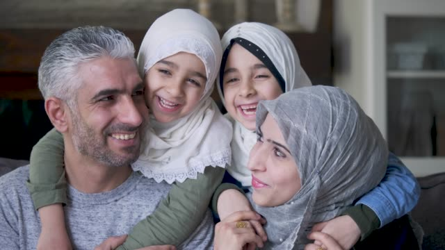 ethnic mother and father posing with their children - middle eastern ethnicity stock videos & royalty-free footage