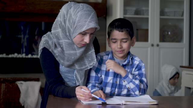ethnic mother helping her son with homework - 40 44 years stock videos & royalty-free footage