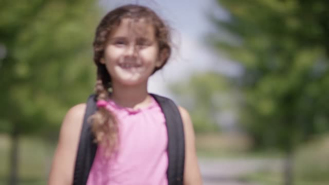 ethnic school girl wearing a back pack approaches - september stock videos and b-roll footage