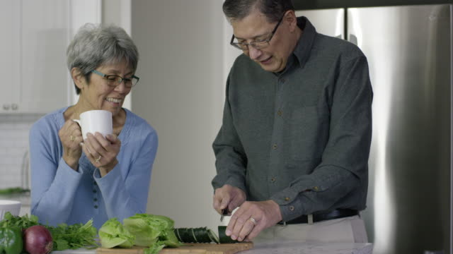 Ethnic Senior Couple Preparing Vegetables in the Kitchen