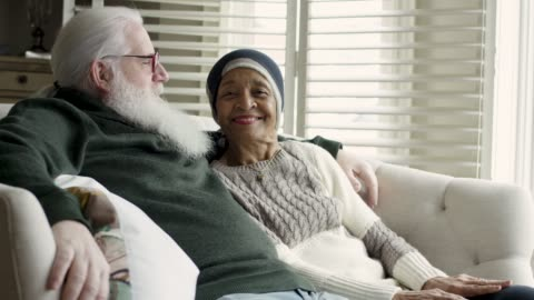 ethnic senior female with cancer relaxes with her caucasian husband - husband stock videos & royalty-free footage