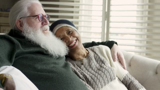 ethnic senior female with cancer relaxes with her caucasian husband - cancer illness stock videos & royalty-free footage