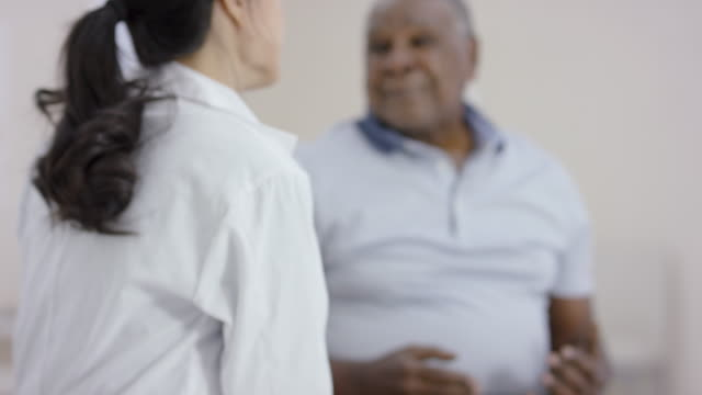ethnic senior man talking to a female doctor during an appointment - diabetes stock videos & royalty-free footage