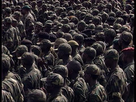 Ethnic violence increasing in Rwanda ITN Rwandan Army soldiers singing in field Paul Kagame dressed in army fatigues making speech to soldiers We...
