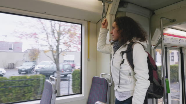 ethnic woman riding the streetcar - portland oregon fall stock videos & royalty-free footage