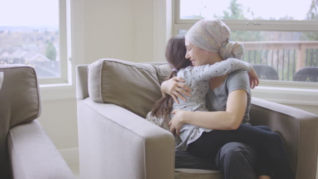 ethnic young adult female with cancer hugging a young girl - chemotherapy drug stock videos & royalty-free footage