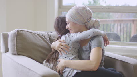 ethnic young adult female with cancer hugging her daughter - completely bald stock videos & royalty-free footage