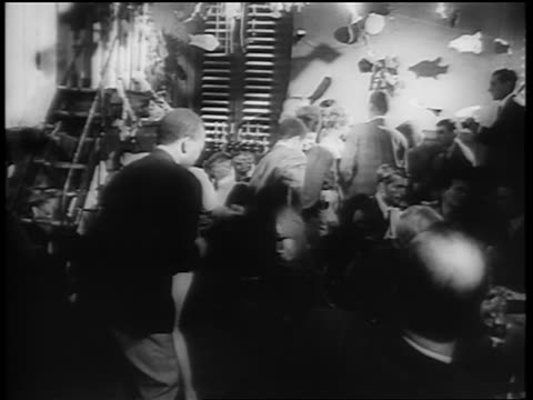 b/w 1961 ethnically diverse crowd dancing the twist on dance floor / newsreel - 1961 stock-videos und b-roll-filmmaterial