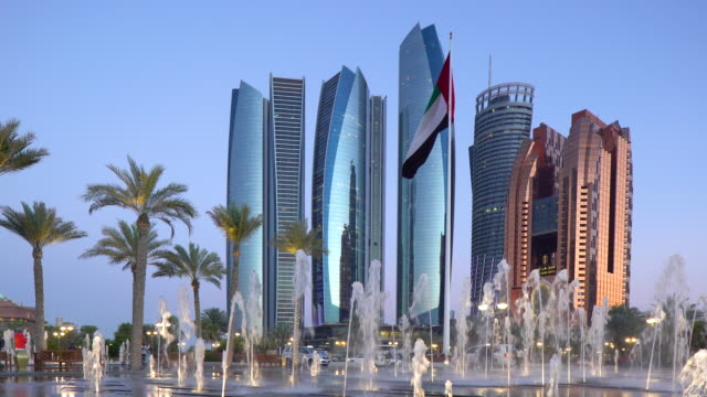stockvideo's en b-roll-footage met etihad towers and emirates palace hotel viewed from the breakwater, abu dhabi, united arab emirates, middle east - famous place
