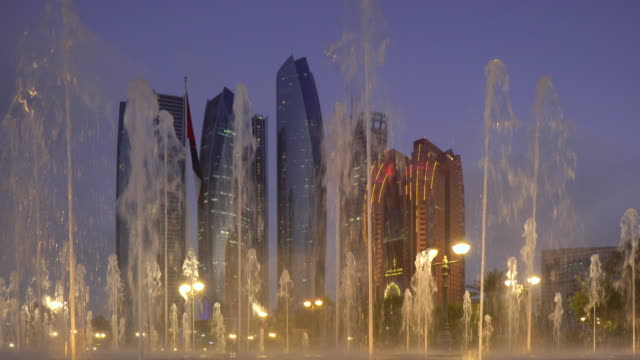 Etihad Towers viewed over the fountains of the Emirates Palace Hotel, Abu Dhabi, United Arab Emirates, Middle East