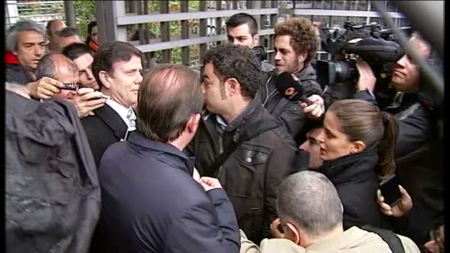madrid various shots of dr fuentes departing court surrounded by press scrum - スクラム点の映像素材/bロール