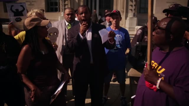 LS Eugene Puryear of ANSWER speaks during the rally outside US Justice Department Washington DC August 27 2014 Activists will rally outside the...