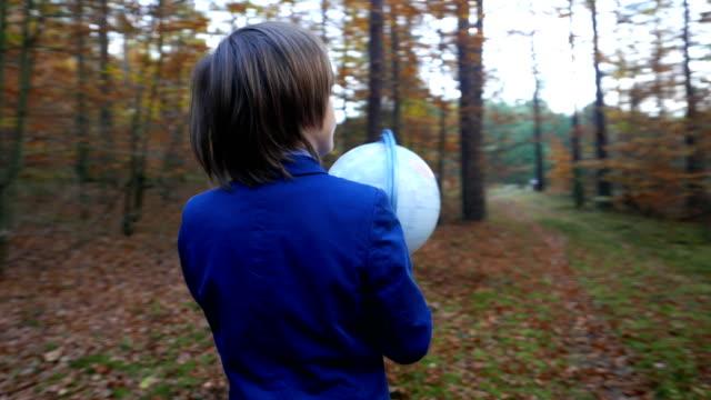eurasian boy with a globe - adult imitation stock videos & royalty-free footage