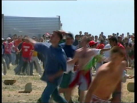 england v germany preperations lib france marseille gvs england and tunisian fans brawling at beach viewing venue during world cup denmark copenhagen... - euro 2000 stock videos & royalty-free footage