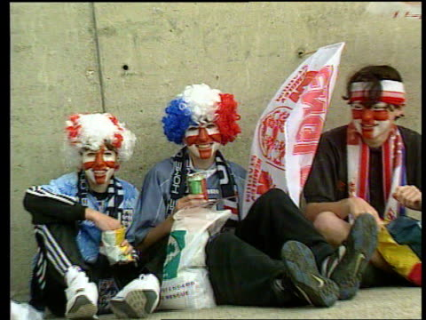 hooligan problem lib england london cms female fan with painted face and red white blue wig pull out as sitting with painted friends mss fans... - hooligan stock videos & royalty-free footage