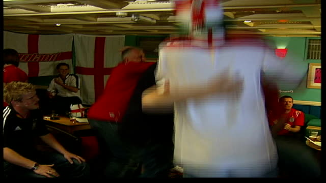 build-up to england v switzerland; itn england: london: fulham: ext goodman i/c in pub with england fans peter power along past hypnotised fans... - hypnosis stock videos & royalty-free footage
