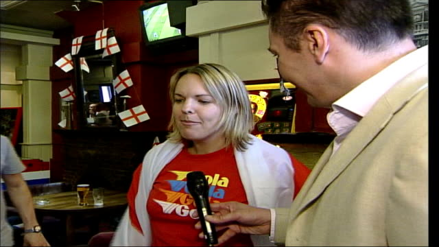 England comes to a standstill ITN Time lapse footage of England supporters in pub gathered to watched England v Switzerland in Euro 2004 match...