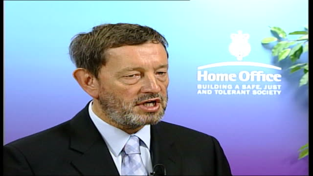 hooligans arrive home itn england london int david blunkett mp interview sot the message is very clear you won't only get immediate and rigorous... - 宣告点の映像素材/bロール