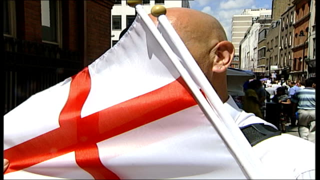 how workers will watch england match; itn england: london: ext dave' interview 'dave' with england flag in front of his face sot - definitely bunking... - lager stock videos & royalty-free footage