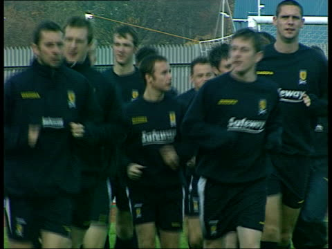 scotland & wales matches; itn scotland: glasgow: hampden park: scotland football squad jogging during training session - playoffs stock videos & royalty-free footage