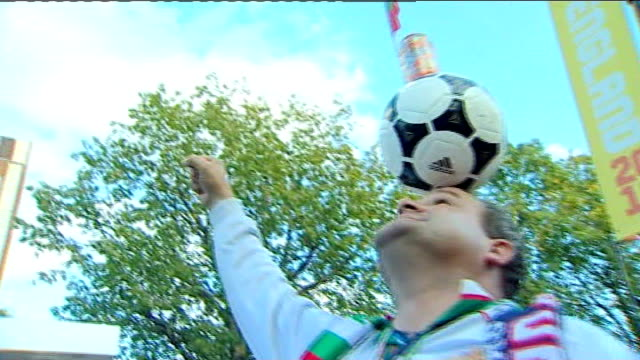 london wembley stadium ext bulgaria fan posing with ball on head with bulgaria flag on top as chants 'bulgaria' sot fans arriving at match - national team stock videos & royalty-free footage