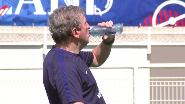 England to face Iceland in knockout matches FRANCE Chantilly EXT Roy Hodgson drinking from bottle of water on pitch England players training on pitch