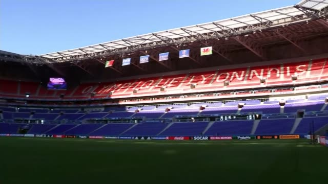 preview of wales v portugal semifinal france leon empty stadium pan euro 2016 logo above tunnel gv empty stadium wales flag - euro 2016 stock videos and b-roll footage