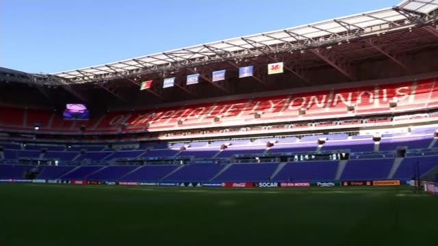 vídeos de stock, filmes e b-roll de preview of wales v portugal semifinal france leon empty stadium pan euro 2016 logo above tunnel gv empty stadium wales flag - euro 2016