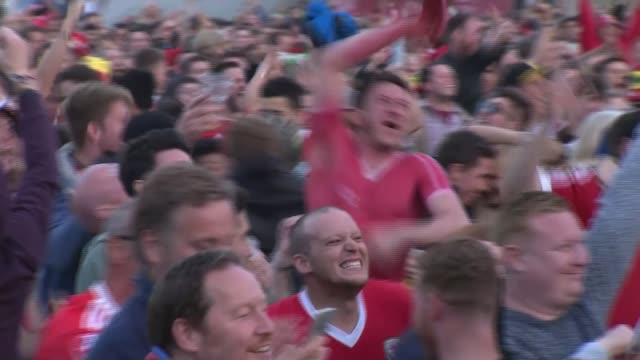 wales team return to heroes welcome dates unkmown fans doing a conga ine cardiff wales fans celebrating in fan zone children singing millennium... - fan enthusiast stock videos & royalty-free footage