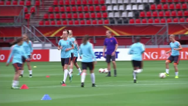 England's women preparing for semi final match THE NETHERLANDS Enschede De Grolsch Veste Stadium Reporter to camera Dutch team training Players on...