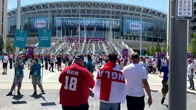 england defeat denmark: montage; england: london: wembley stadium: ext england fans along to stadium - film montage stock videos & royalty-free footage