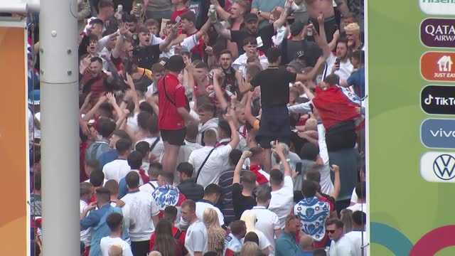 england fans gather at wembley stadium ahead of final; england: london: wembley way: ext crowds of england fans with england flags surrounding and... - smoke physical structure stock videos & royalty-free footage